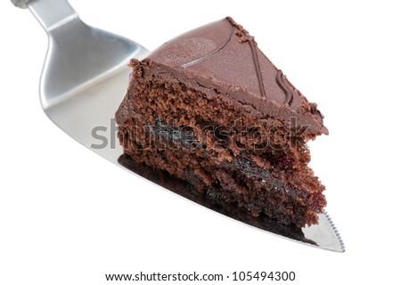 slice chocolate cake on knife, isolated on white