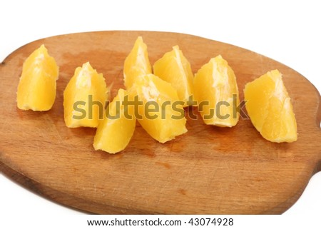 slice circle of sweet tasty orange - isolated on wooden  board
