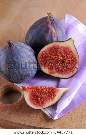 slice fig on wood background