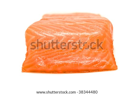 Slice of appetizing red fish on a white background
