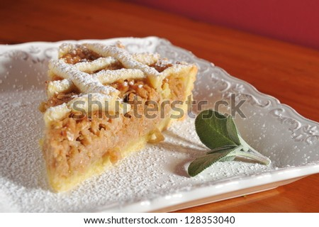 Slice of apple fruit pie on a plate