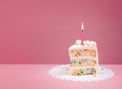 Slice of Birthday Cake with candle over a pink background.