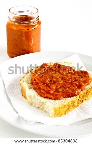 Slice of bread smeared with chutney on white bread