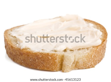 Slice of bread with cheese cream spread on it