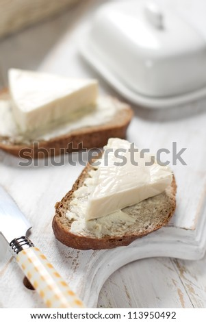 Slice of bread with cream cheese for breakfast