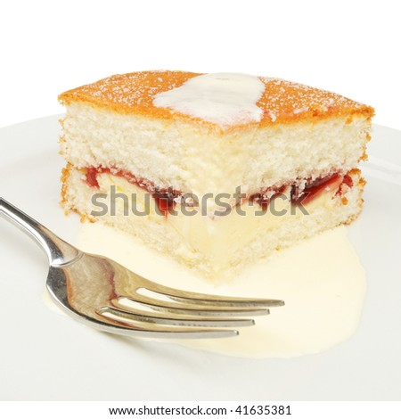 Slice of cake with cream and a fork on a white plate