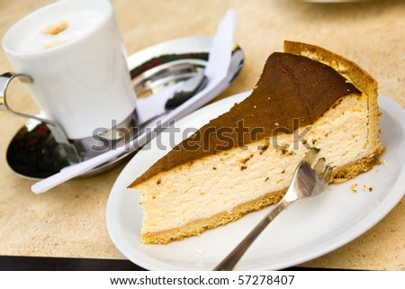 slice of cheese cake with coffee