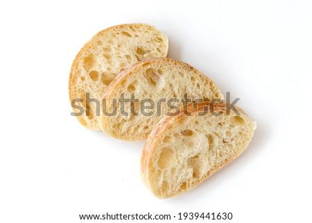 Slice of Chiabata bread isolated on white background, top view. Sliced Italian ciabatta.