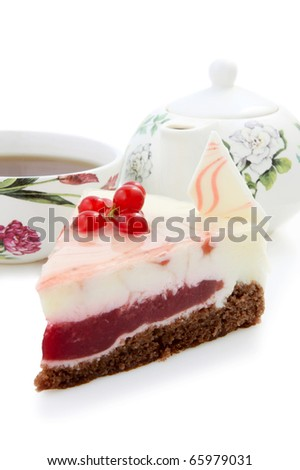 Slice of  currant cheesecake  with cup of tea on White Background.