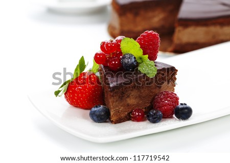 slice of delicious chocolate cake over white - stock photo