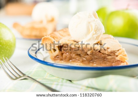 Slice of Fresh Homemade Apple Pie with Scoop of Ice Cream