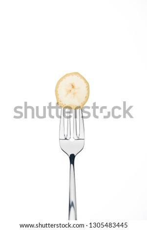 slice of fresh sweet banana on fork isolated on white isolated on white isolated on white #1305483445