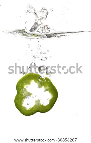 slice of green bell pepper capsicum splash in water