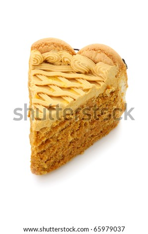 Slice of honey and nut cream cake  on white isolated background