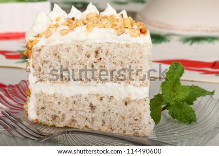 Slice of layer cake on a glass plate