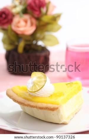 slice of lemon cheese cake with flower