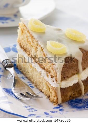 Slice of Lemon Drizzle Cake - stock photo