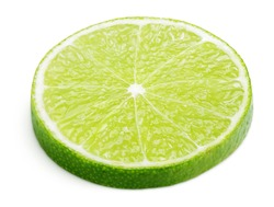 Slice of lime citrus fruit lying down isolated on white background with clipping path