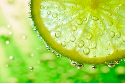 slice of lime with bubbles