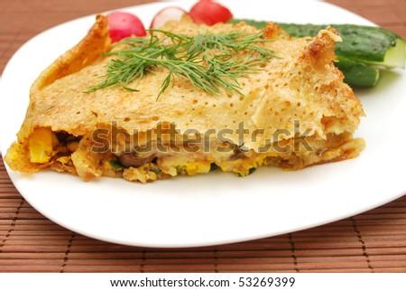 slice of pancake pizza (mushroom and egg filling) and vegetables