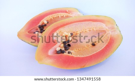 slice of papaya isolated on white background #1347491558