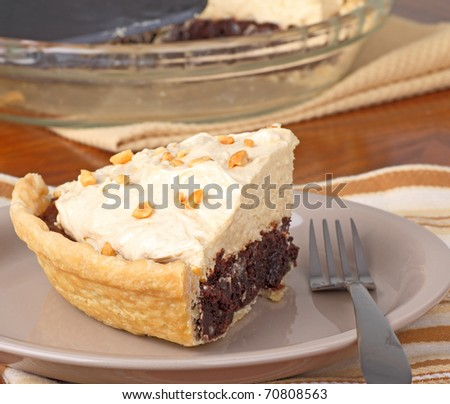Slice of peanut butter chocolate brownie pie on a plate