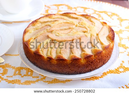 Slice of pear topped cake on plate