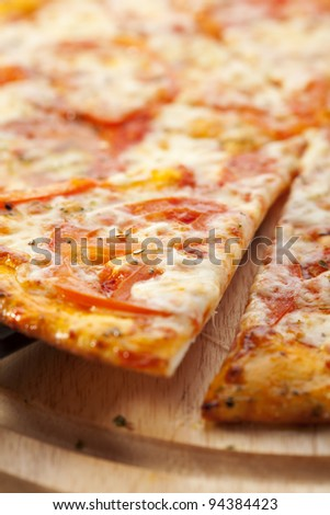 Slice of Pizza Margherita made with Tomatoes, Gauda Cheese and Mozzarella