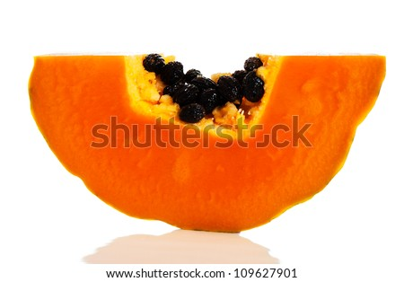 Slice of ripe orange papaya or pawpaw a popular tropical fruit with a sweet flesh
