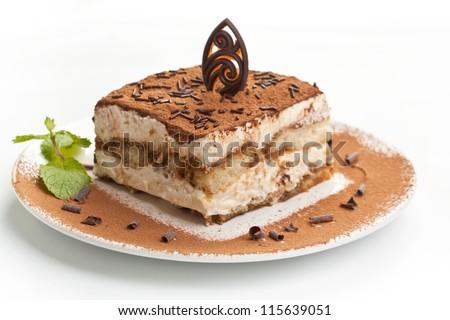 Slice of self-made italian tiramisu dessert served on a plate