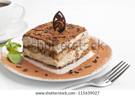 Slice of self-made italian tiramisu dessert served on a plate on white background