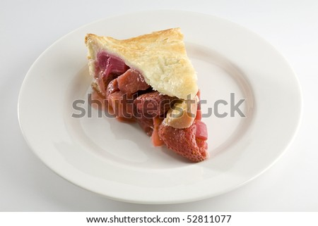 Slice of strawberry and rhubarb pie on white plate