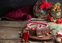 Slice of sweet chocolate cake for Christmas Eve. Christmas decoration.