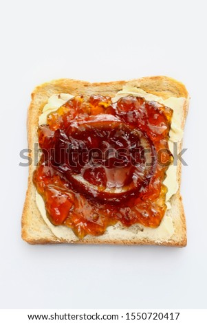 Slice of toast with homemade orange marmalade