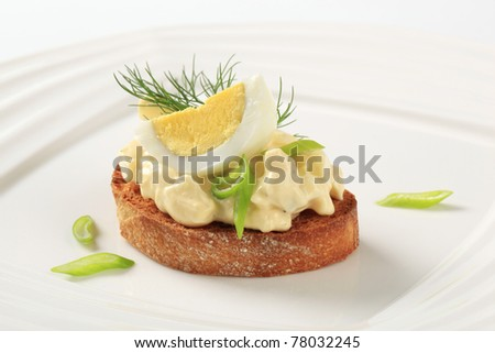 Slice of toasted bread and egg spread