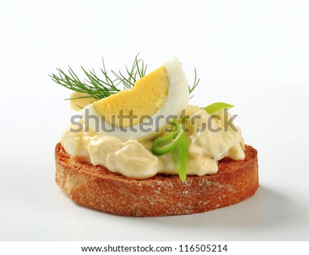 Slice of toasted bread with egg spread