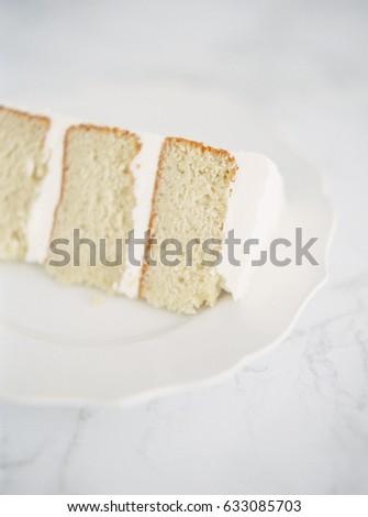 Slice of Vanilla Cake with White Icing