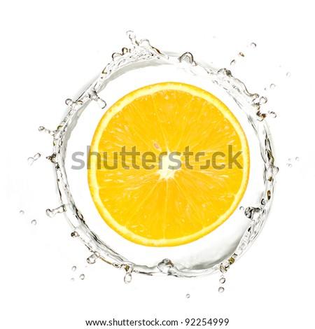 Slice of yellow mandarin or orange in water splash