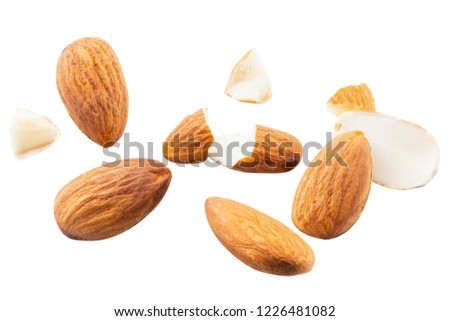 slice peeled Almond nut Blast scattered broken with explosion raw almonds on white isolated #1226481082