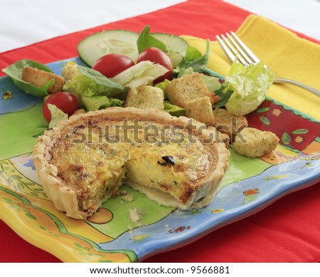 stock-photo-slice-removed-from-quiche-with-a-salad-9566881.jpg