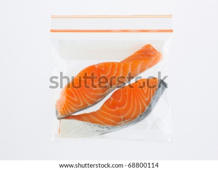 Slice salmon in safety zipper bag isolated