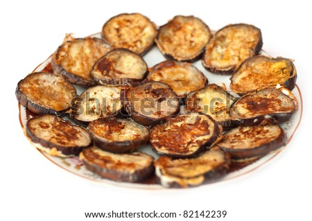sliced and fried aubergines with egg and mayonaise - stock photo