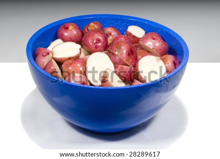 Sliced and Prepared Pink or Red Rose Potatoes in a Bowl.