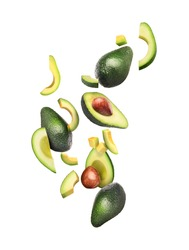 Sliced and whole avocado in flight on a white background
