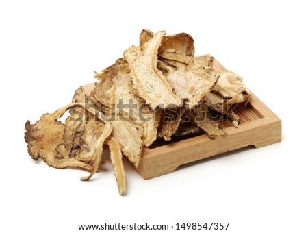 Sliced Angelica Sinensis or Dang Gui on white background #1498547357