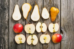 sliced apples and pears on old wood table
