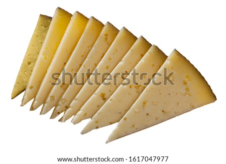 Sliced artisanal semi hard ewes milk cheese. Isolated over white background