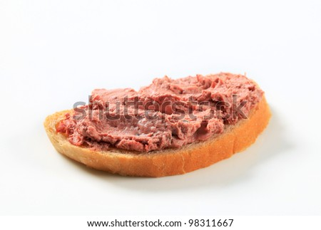 Sliced baguette with pate