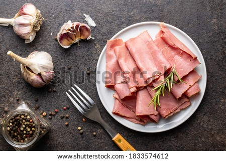 Sliced beef ham on plate. Top view. Photo stock ©