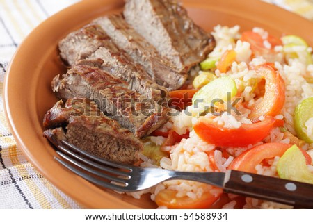 Sliced beef steak with rice and vegetables